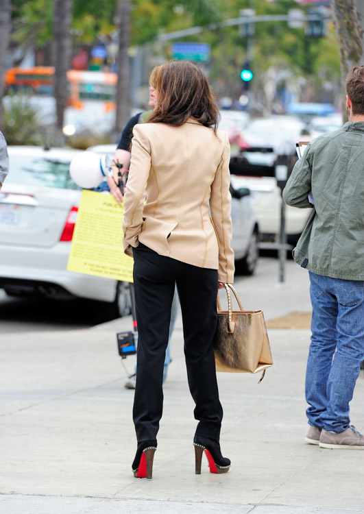 Lis Vanderpump carries a gold Le Testament D'alexander Mcqueen Arte Replay Whipstitched Tote while scouting a new restaurant location in West Hollywood (3)